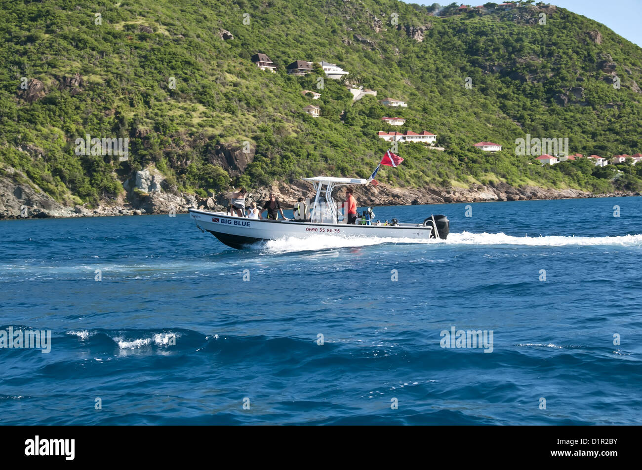 Scuba diving boat with dive flag speeding toward dive site, Saint Barthelemy - Stock Image