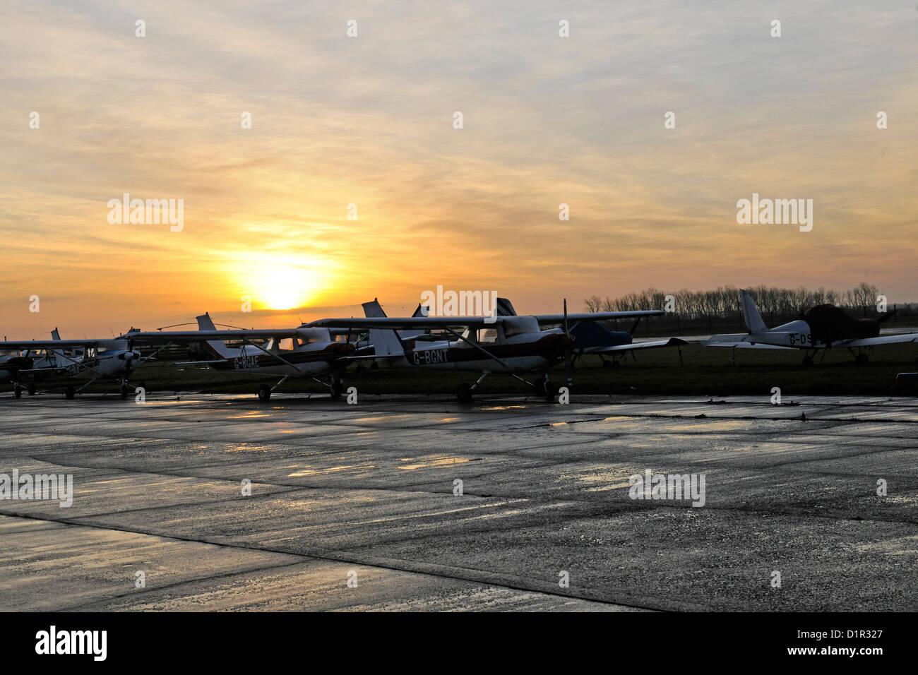 Photo of light aircraft at Peterborough Conington airport at dawn - Stock Image