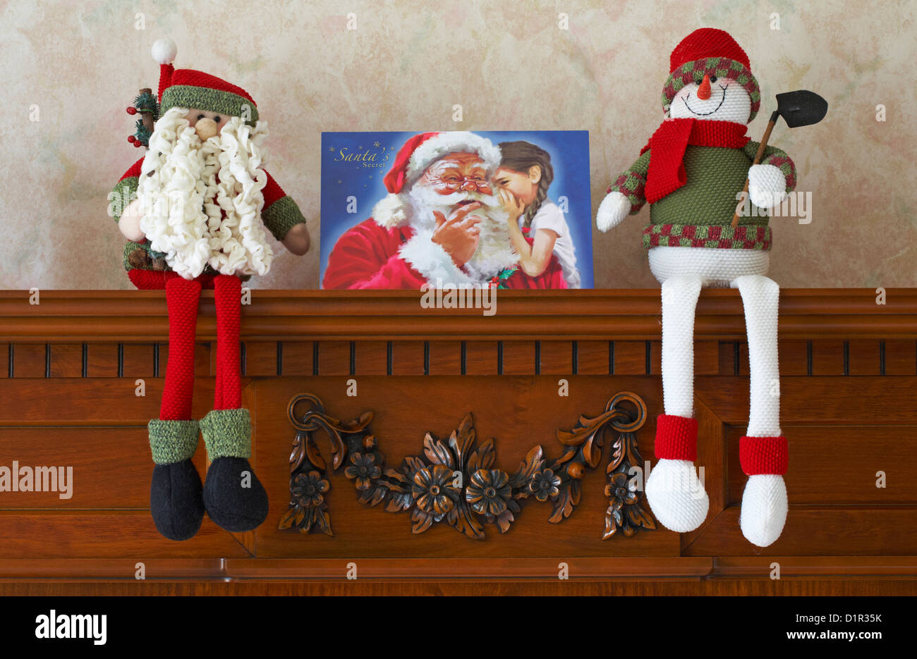 Christmas decorations and Christmas card on mantelpiece in lounge of ...
