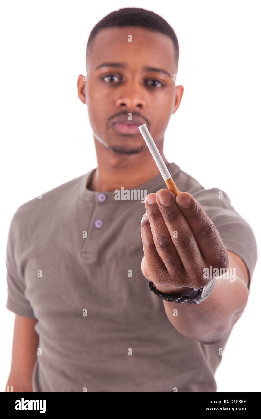 Young african american man offering a cigarette, isolated on white background - Stock Image