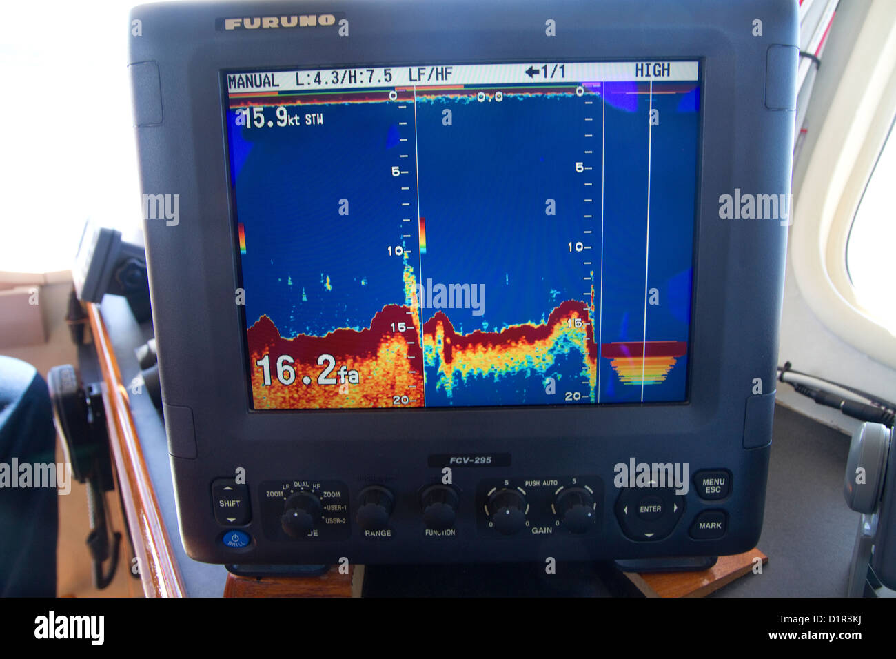 Charter fishing boat display of a fish finder/depth finder sonar in the Pacific Ocean, Oregon, USA. - Stock Image
