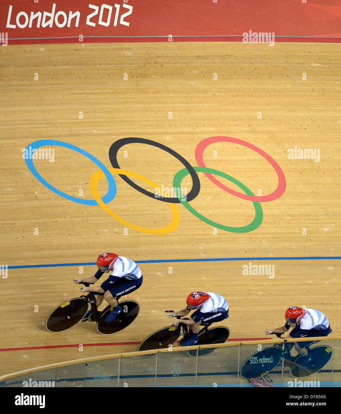 The Team GB Pursuit team go past the Olympic rings. Olympic rings on the track. Track Cycling - Stock Image