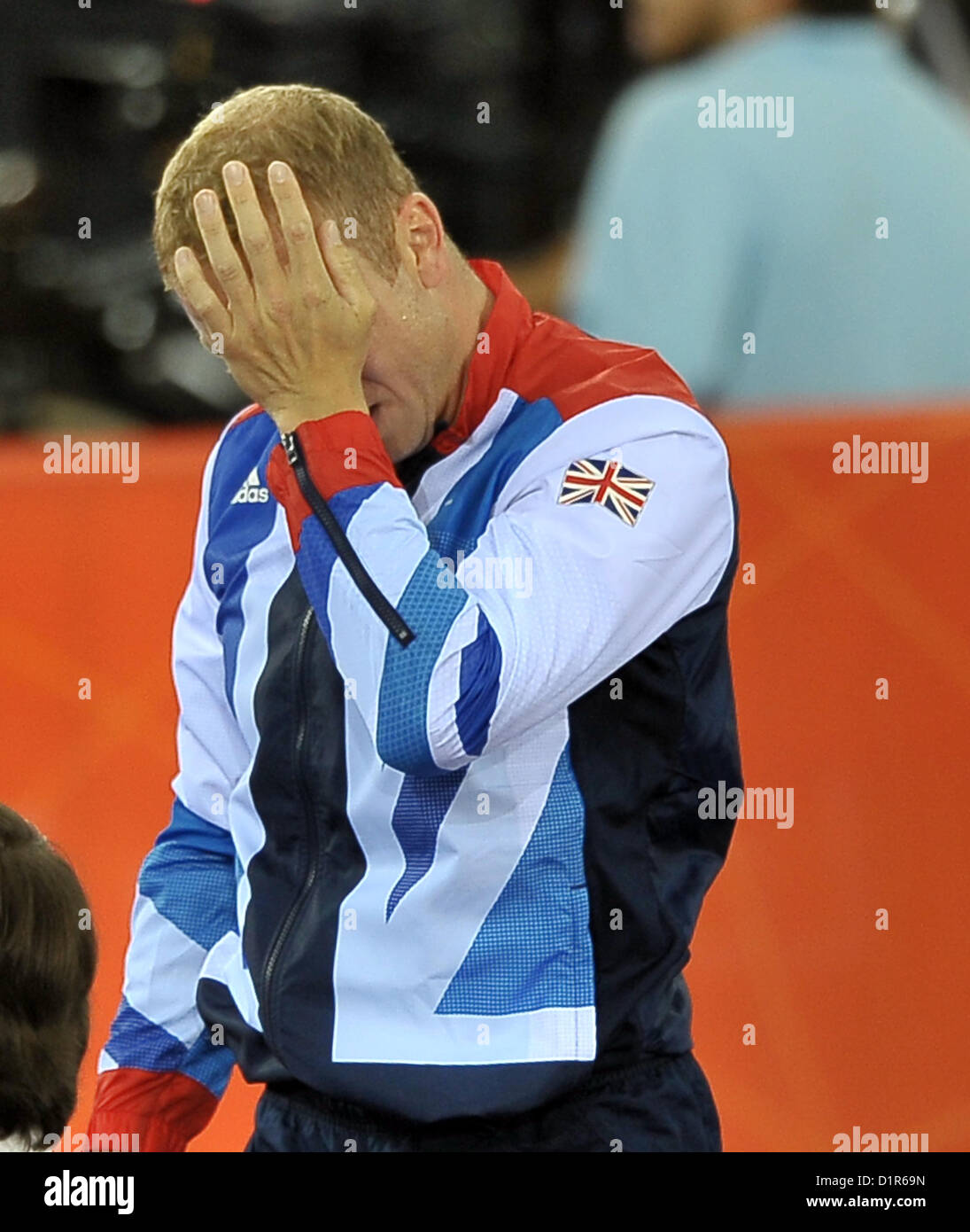 Chris Hoy (GBR, Great Britain) wipes a tear from his eye as he steps onto the podium. Track Cycling - Stock Image