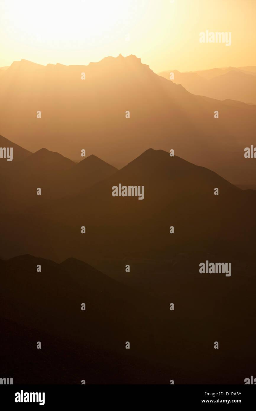 Morocco, Agdz, Sunrise over the mountains. - Stock Image