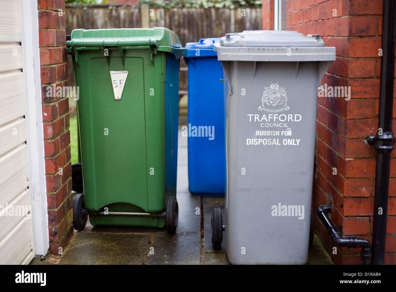 Wheelie bins in a garden in Manchester, England, UK - Stock Image