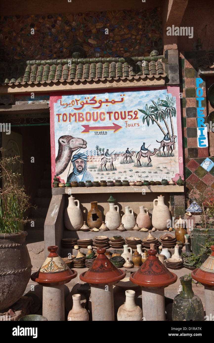 Morocco, Tamegroute, near Zagora, Road camel sign Tombouctou 52 jours. Timbuktu 52 days. - Stock Image