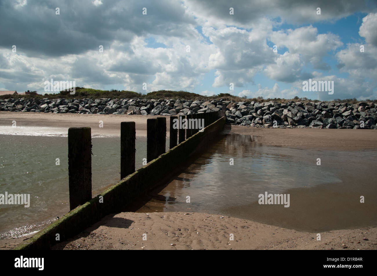 Beach,breaker,puddles.sand - Stock Image