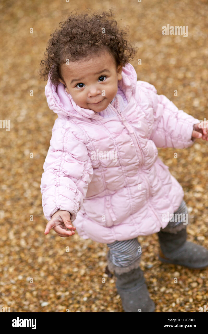 Outdoors Portrait Of Cute Happy Toddler Mixed Race Girl
