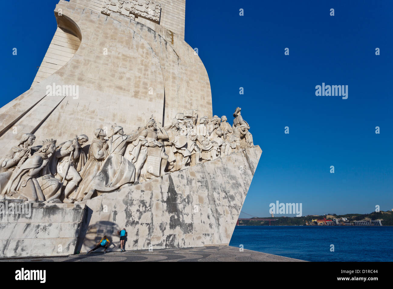 Closeup of the statues of the Monument to Discoveries in Lisbon Harbor honoring Portugal's explorers - Stock Image