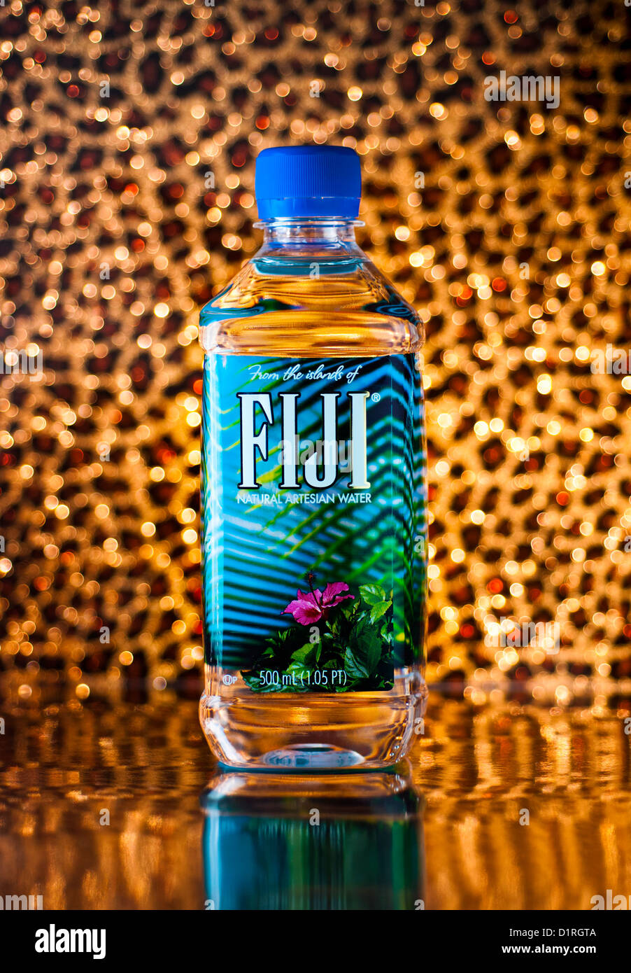Fiji Water bottle with an artistic background - Stock Image