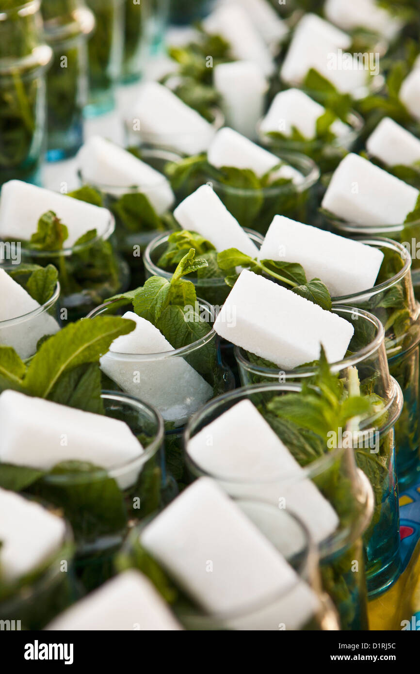Morocco, Marrakech, Glasses with sugar and fresh mint for mint tea. - Stock Image