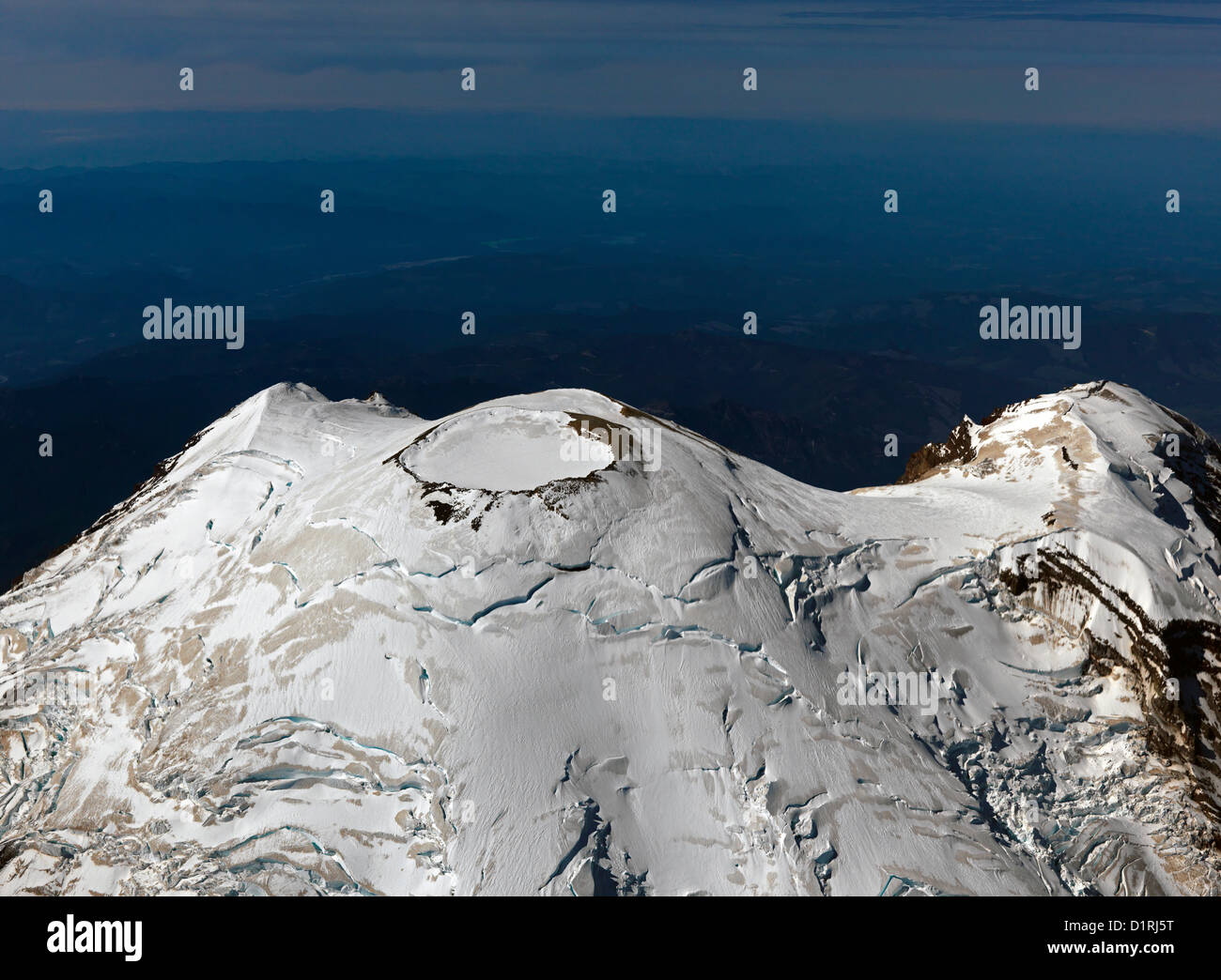 Mount Rainier just east of Seattle and aerial photo. Mount Rainier National Park is the gateway for mountaineering - Stock Image