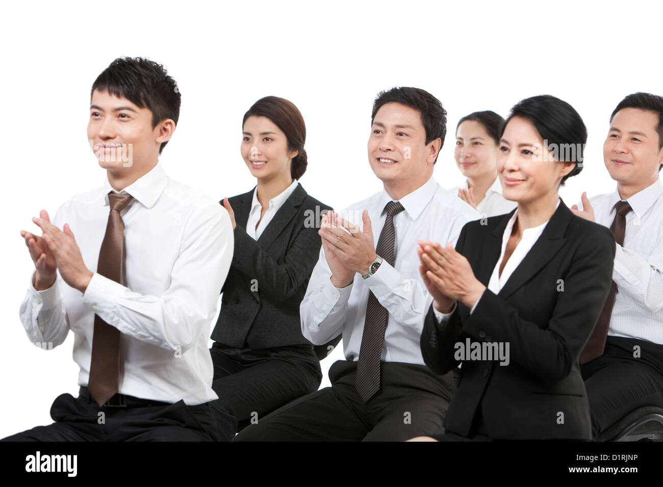 Cheerful business persons clapping in a meeting - Stock Image