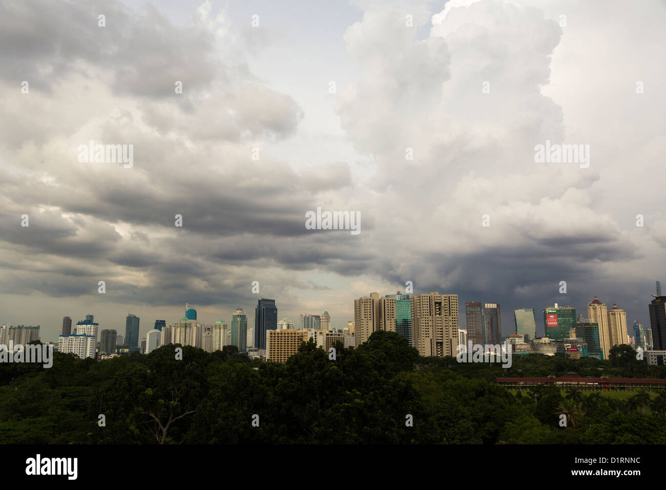Jakarta central business district skyline with on overcast sky, Indonesia - Stock Image