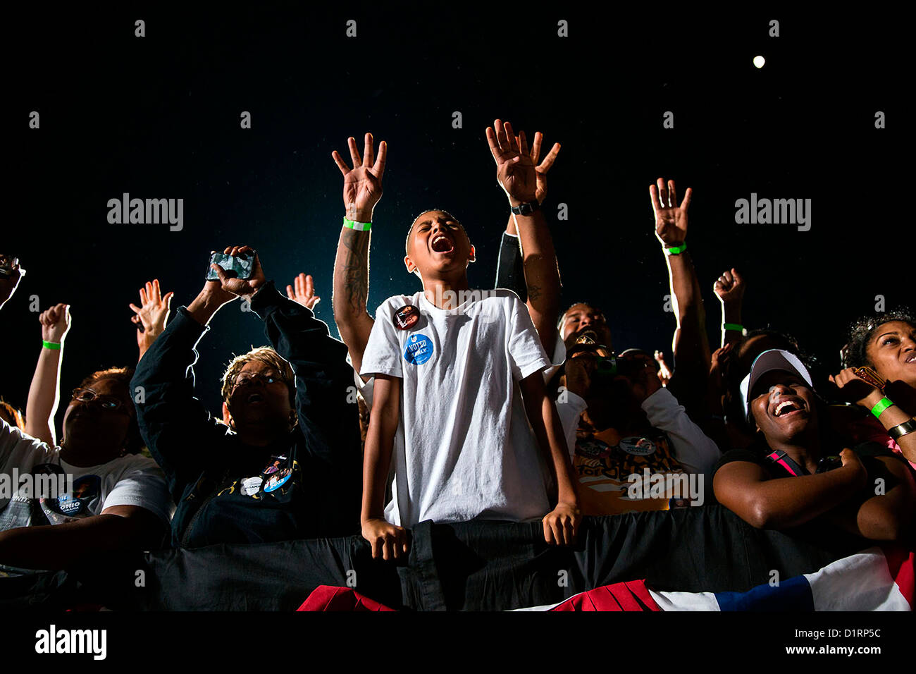 A young boy reacts during a late night campaign rally for President Barack Obama Oct. 25, 2012 in Cleveland, Ohio - Stock Image