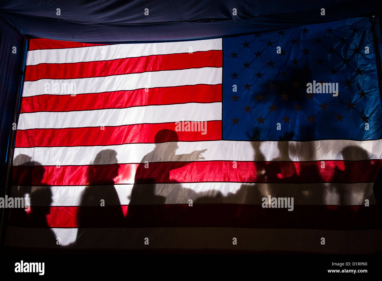 US President Barack Obama is silhouetted against a American flag during an evening campaign rally November  3, 2012 - Stock Image