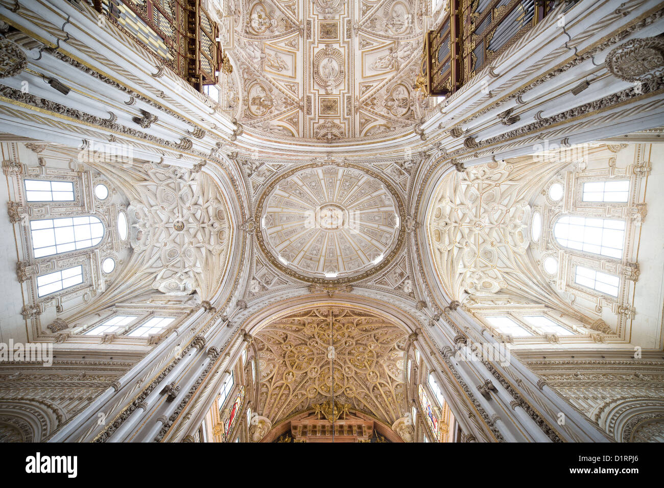 Mezquita Cathedral interior, ribbed vaulted ceilings and dome of the transept in Cordoba, Spain. - Stock Image