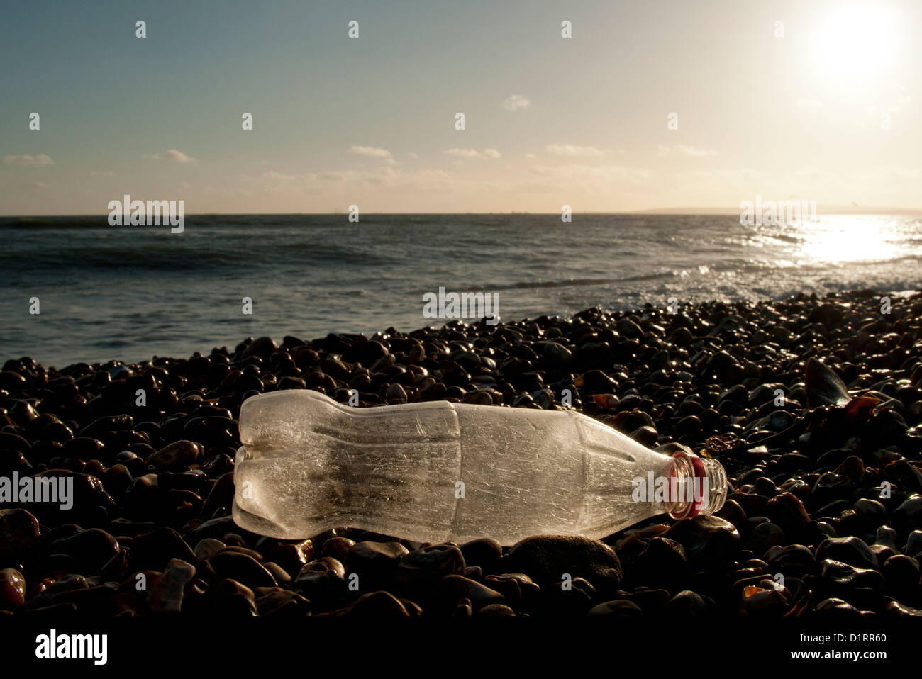coke bottle washed up on the beach - Stock Image