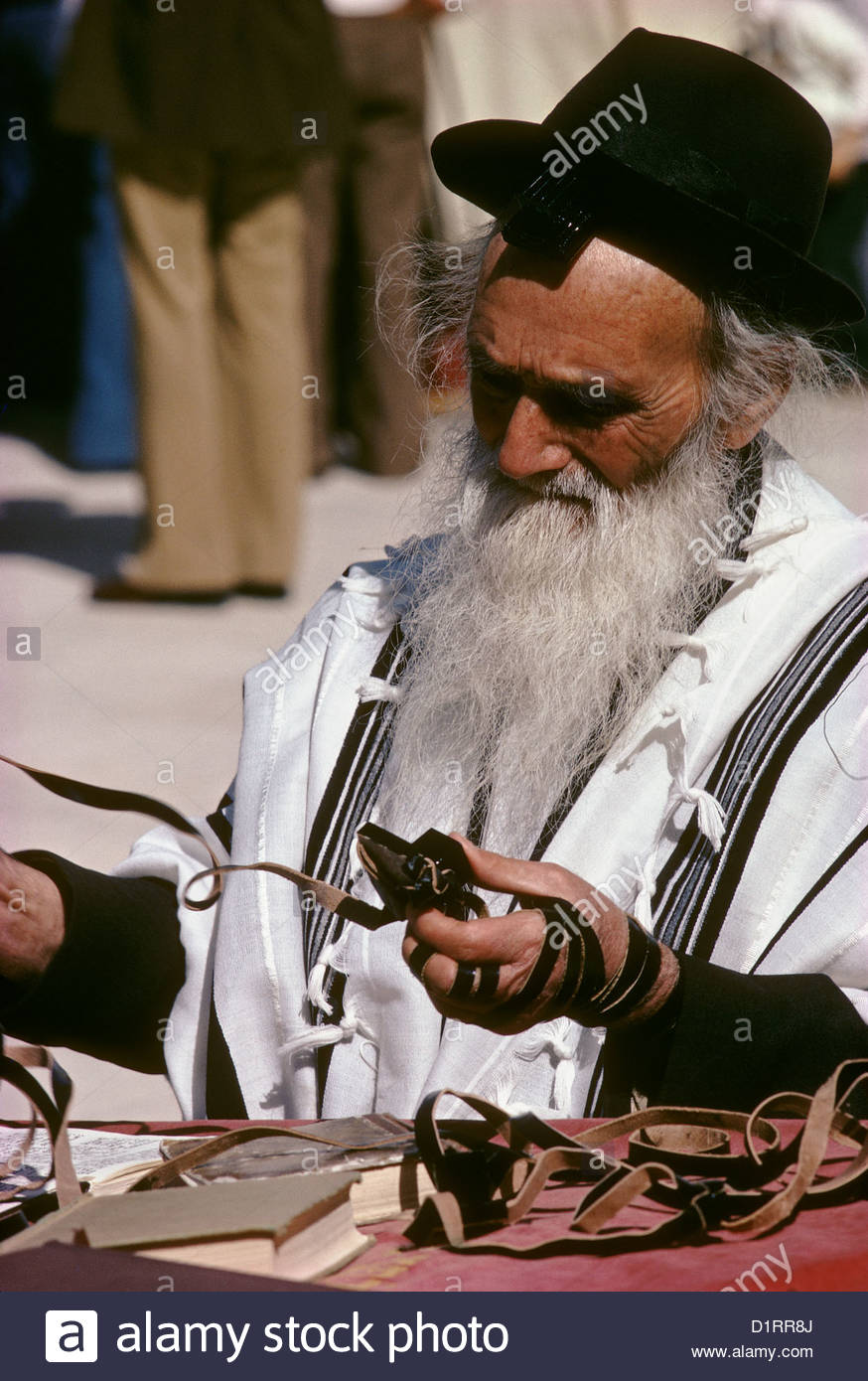 ISRAEL Old Jerusalem at the Wailing Wall during a bar-mitszva a Rabbin wearing a tefillin containing verses of the - Stock Image