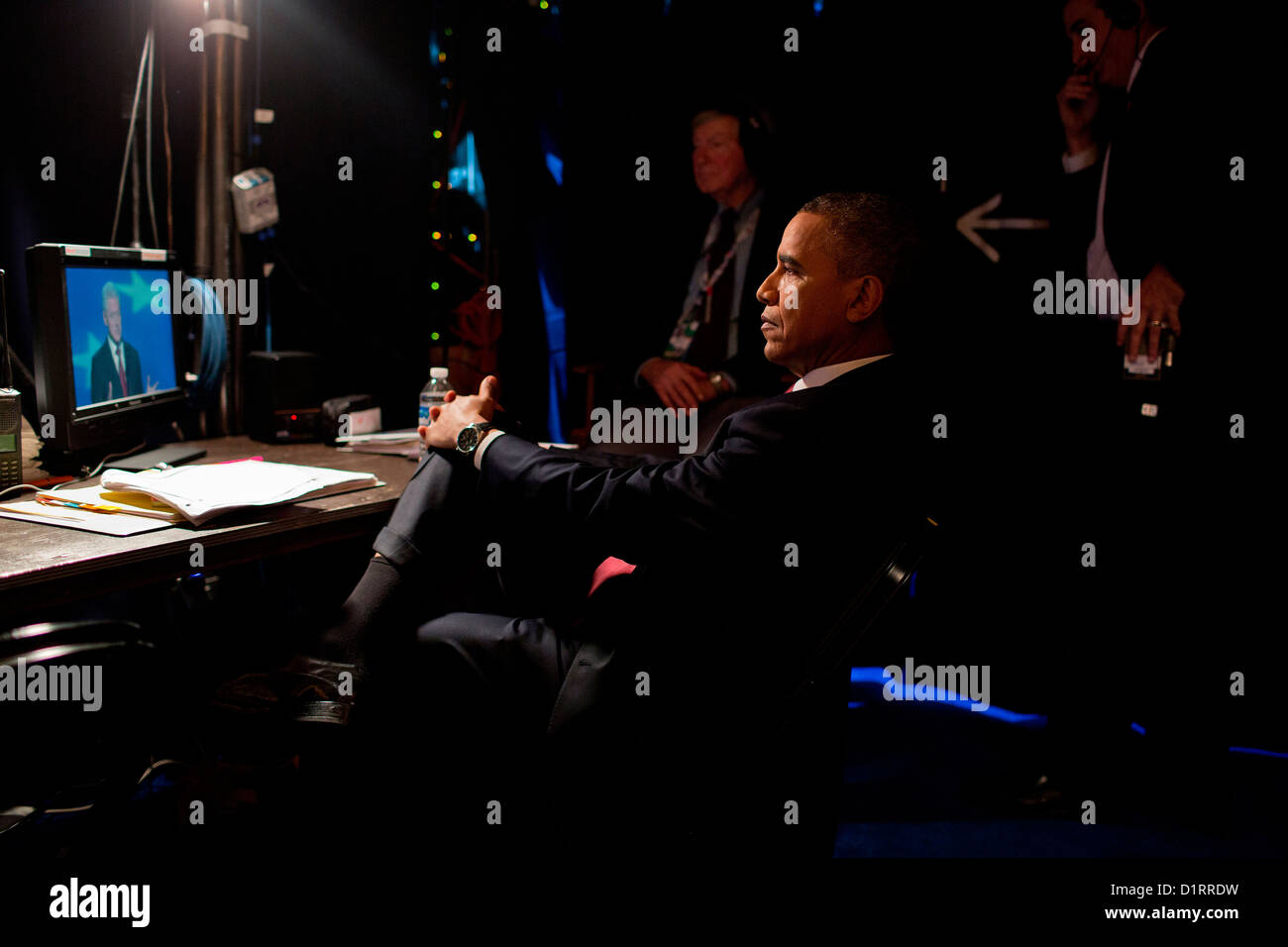 US President Barack Obama watches former President Bill Clinton speak from backstage at the Democratic National - Stock Image
