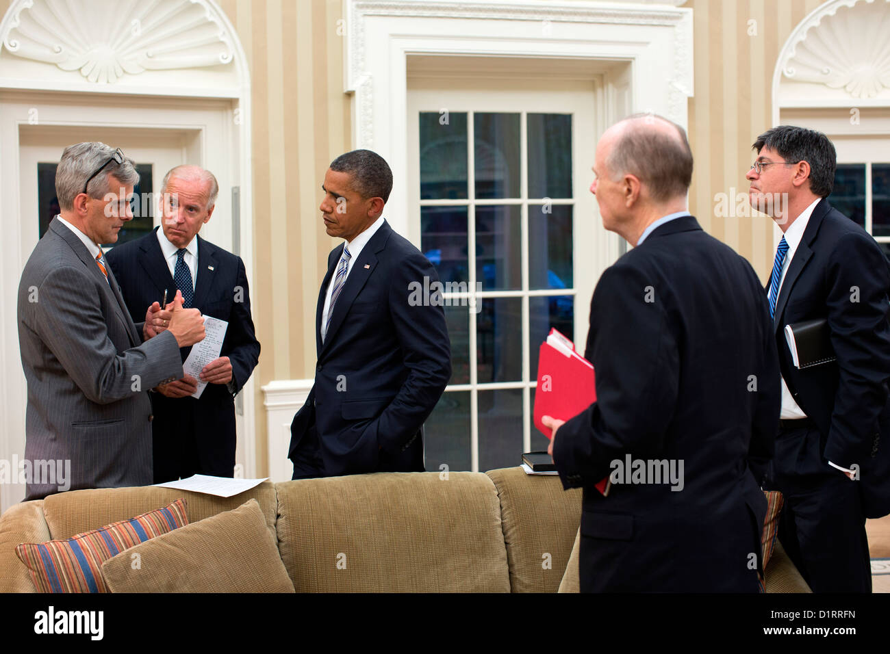 US President Barack Obama and Vice President Joe Biden are updated on the situation in Libya by Deputy National - Stock Image