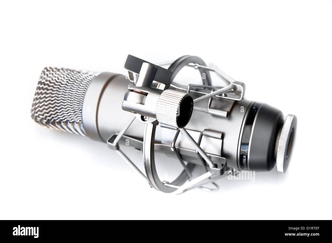 closeup of vintage microphone on white background - Stock Image