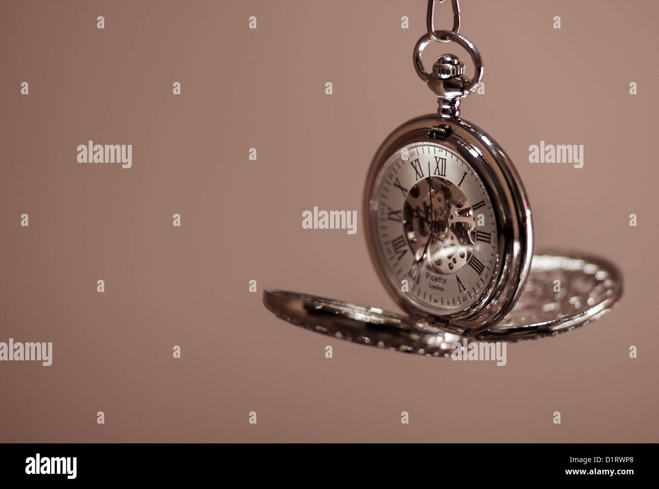 A handwound clockwork pocket, or fob, watch. - Stock Image