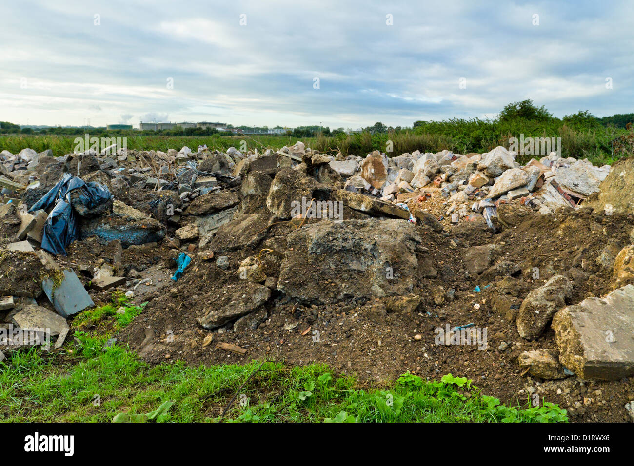 Fly tipping. Illegal dumping of construction waste on farmland, Nottinghamshire, England, UK - Stock Image