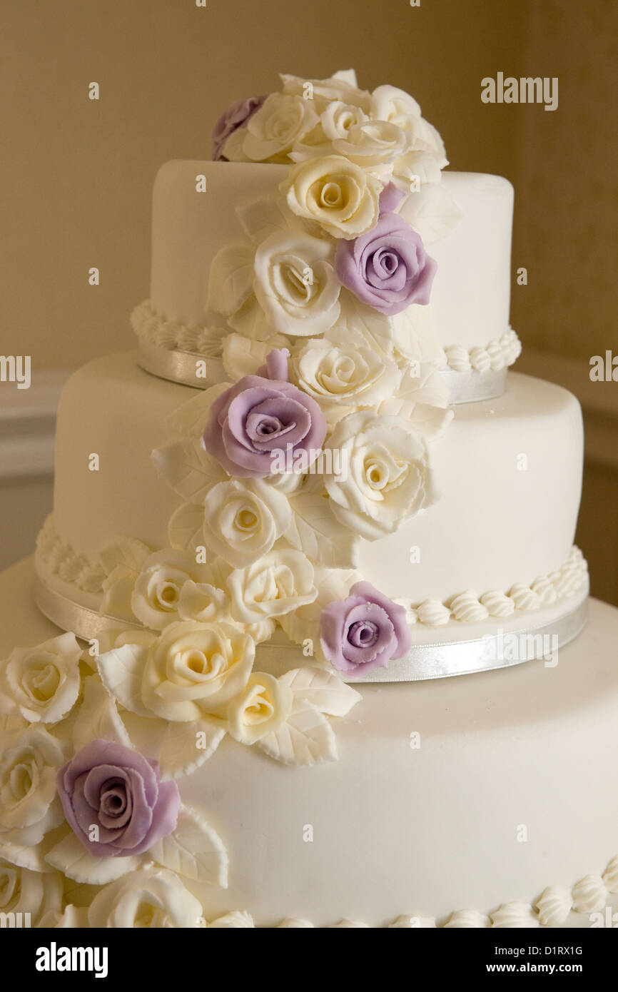 Three tiered wedding cake with white and purple flowers stock photo three tiered wedding cake with white and purple flowers mightylinksfo