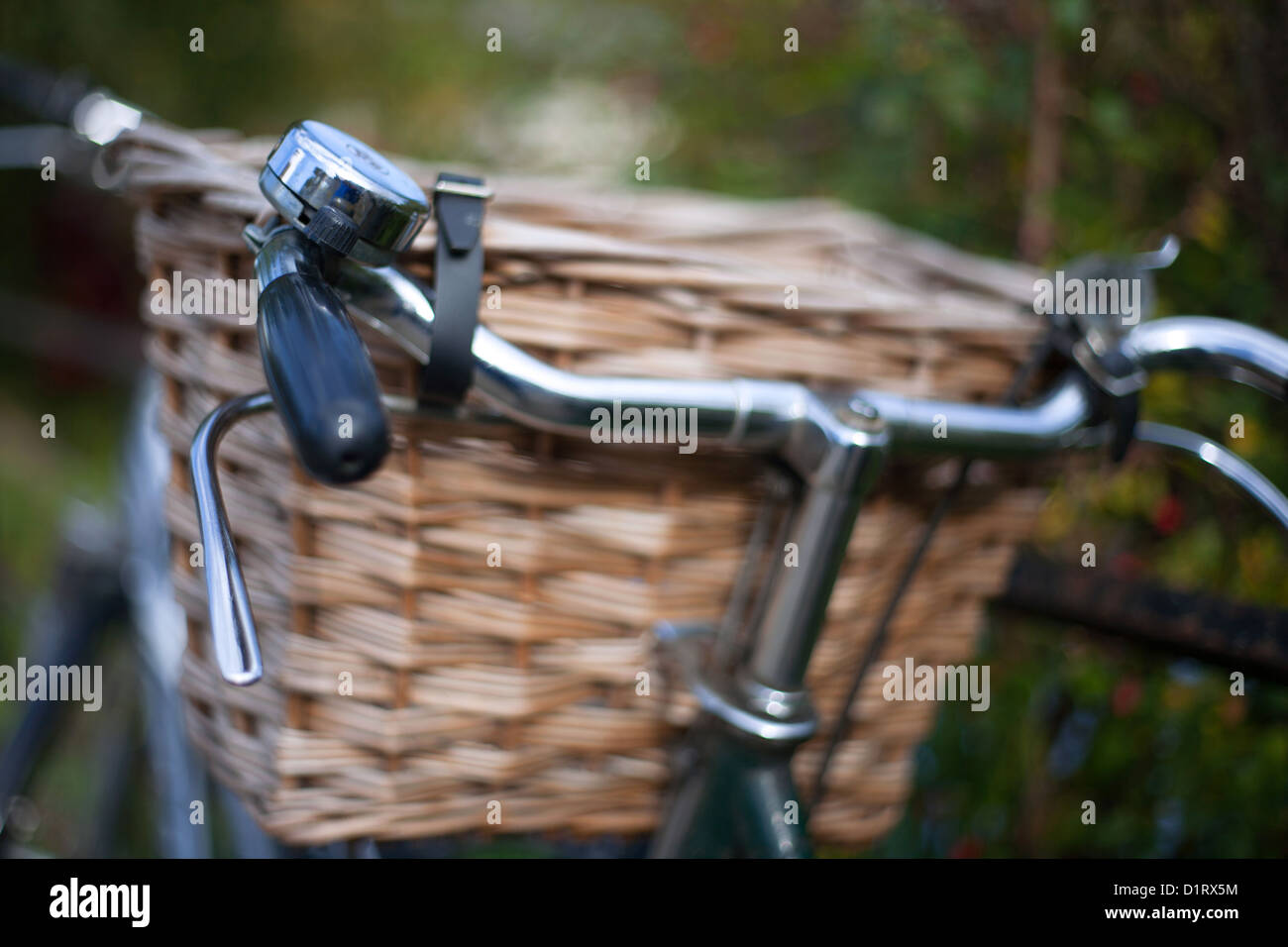 Bicycle wicker basket handlebars and bell - Stock Image