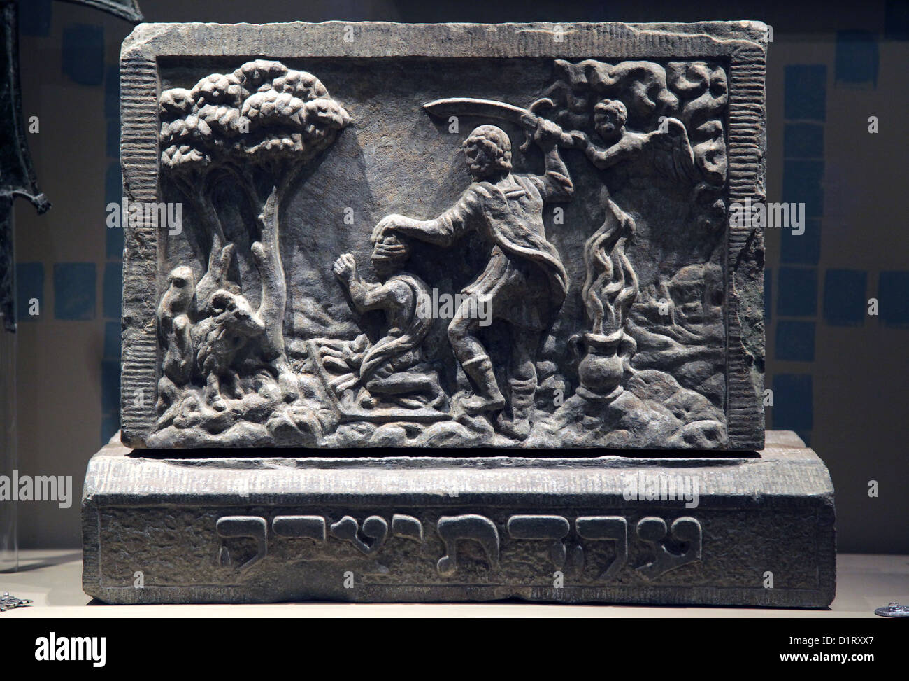 Stone plaque from a house in Amsterdam depicting Abraham's sacrifice,The tying of Isaac,17 th century. - Stock Image