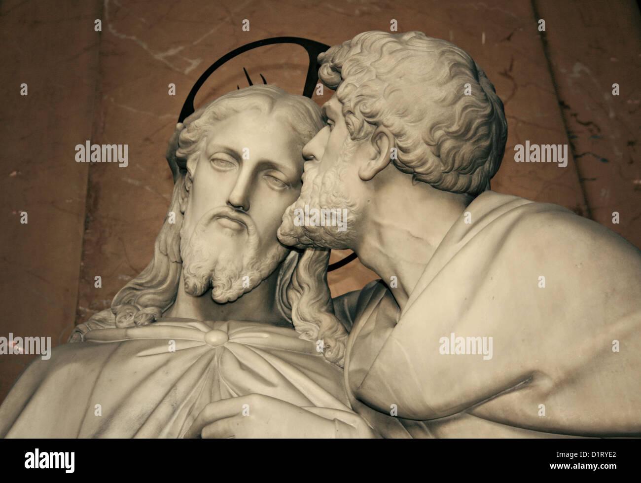 Kiss of Judas. Marble statue beside the Scala Sancta in the Lateran Palace, Jesus and Judas - Stock Image