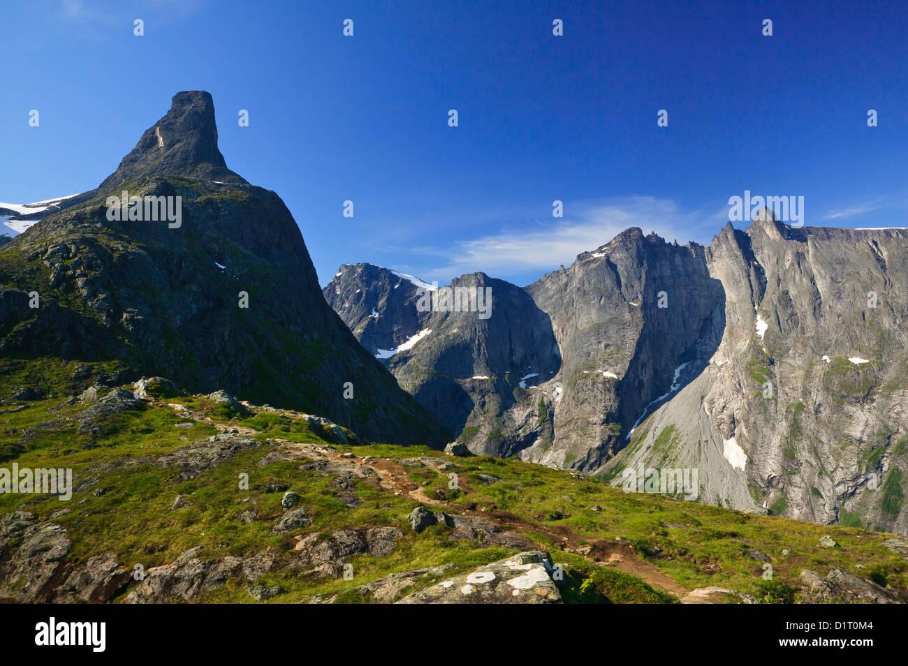 The peak Romsdalshorn (left) and the Troll Wall and Trolltindane (background) in Romsdalen valley, Møre og - Stock Image