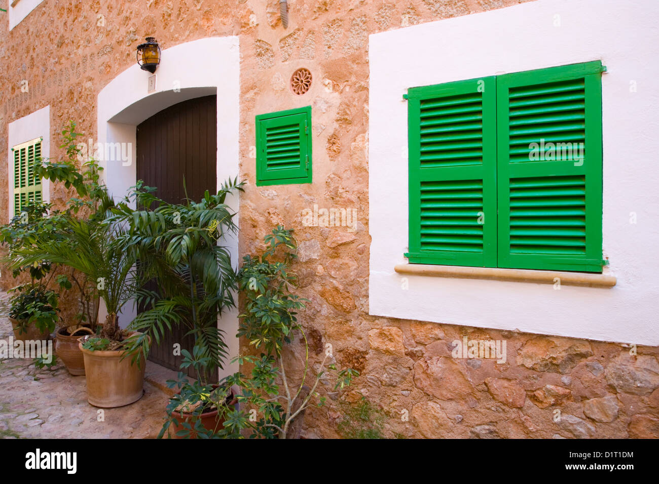 Fornalutx, Mallorca, Balearic Islands, Spain. Typical green-shuttered windows in the heart of the village. Stock Photo