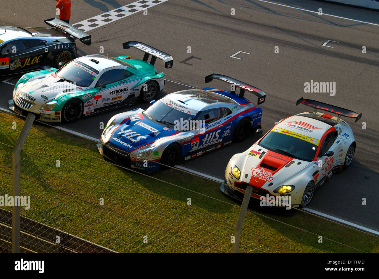 SuperGT cars stop at the finishing line at Super GT race on June 20, 2010 in Sepang Circuit, Malaysia. - Stock Image