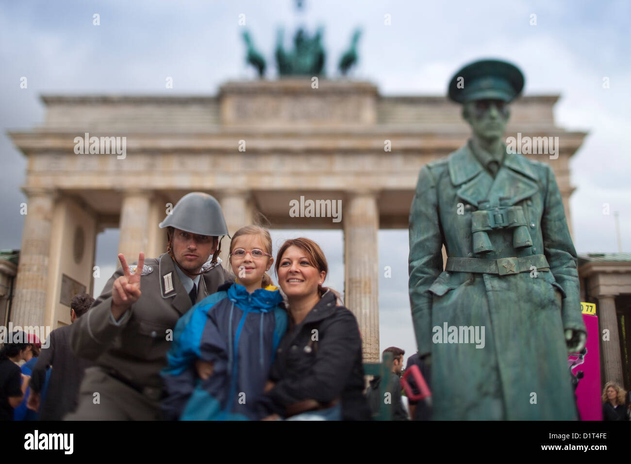 Berlin, Germany, tourists and a living statue in front of the Brandenburg Gate Stock Photo