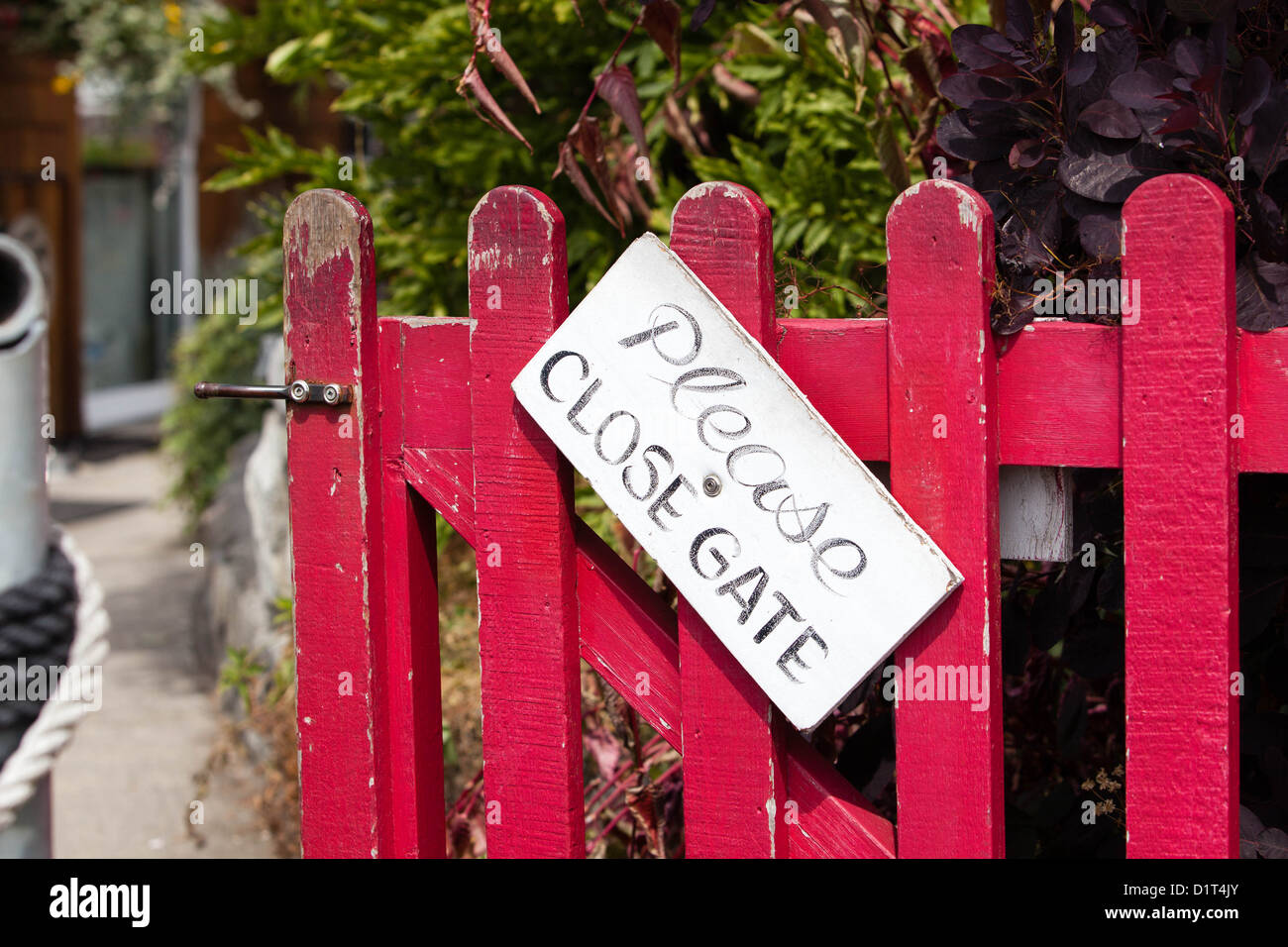 """Wooden door with sign """"please close gate"""" Stock Photo"""