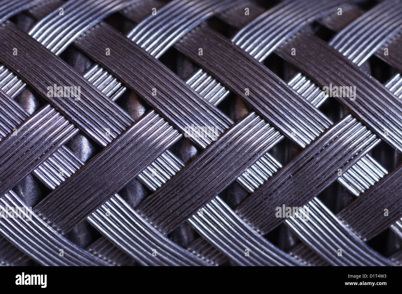 macro image of a metal wire braided reinforced hose - Stock Image