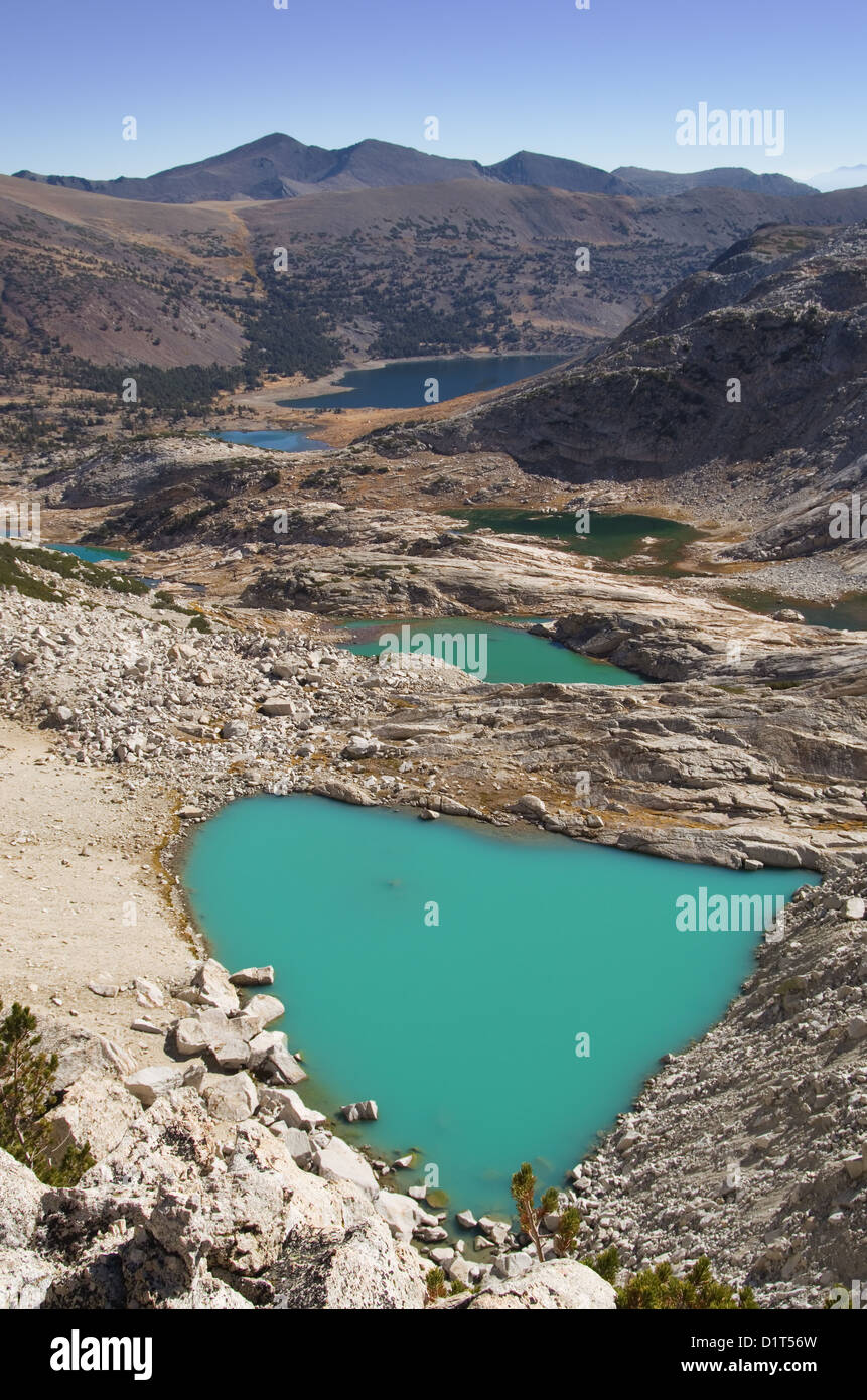 glacial lakes below Mount Conness with milky blue glacial water - Stock Image