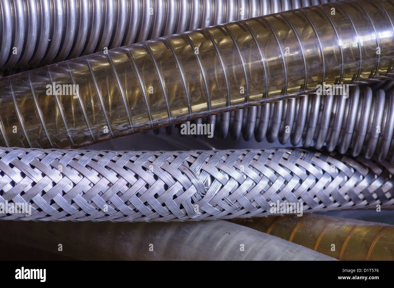 close up image of a number of reinforced vacuum hoses - Stock Image