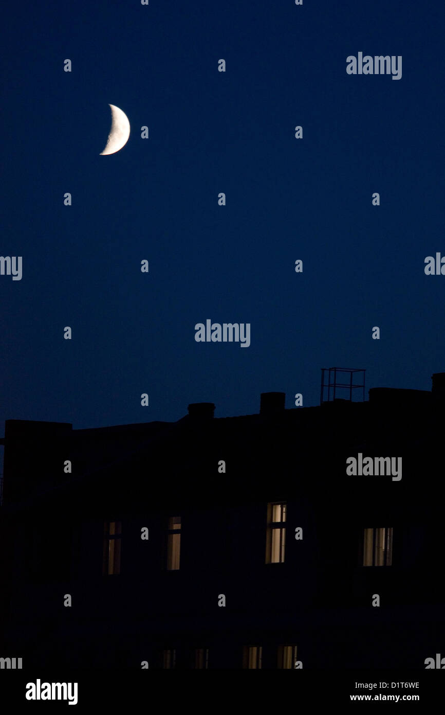 Berlin, Germany, the crescent moon over a house - Stock Image