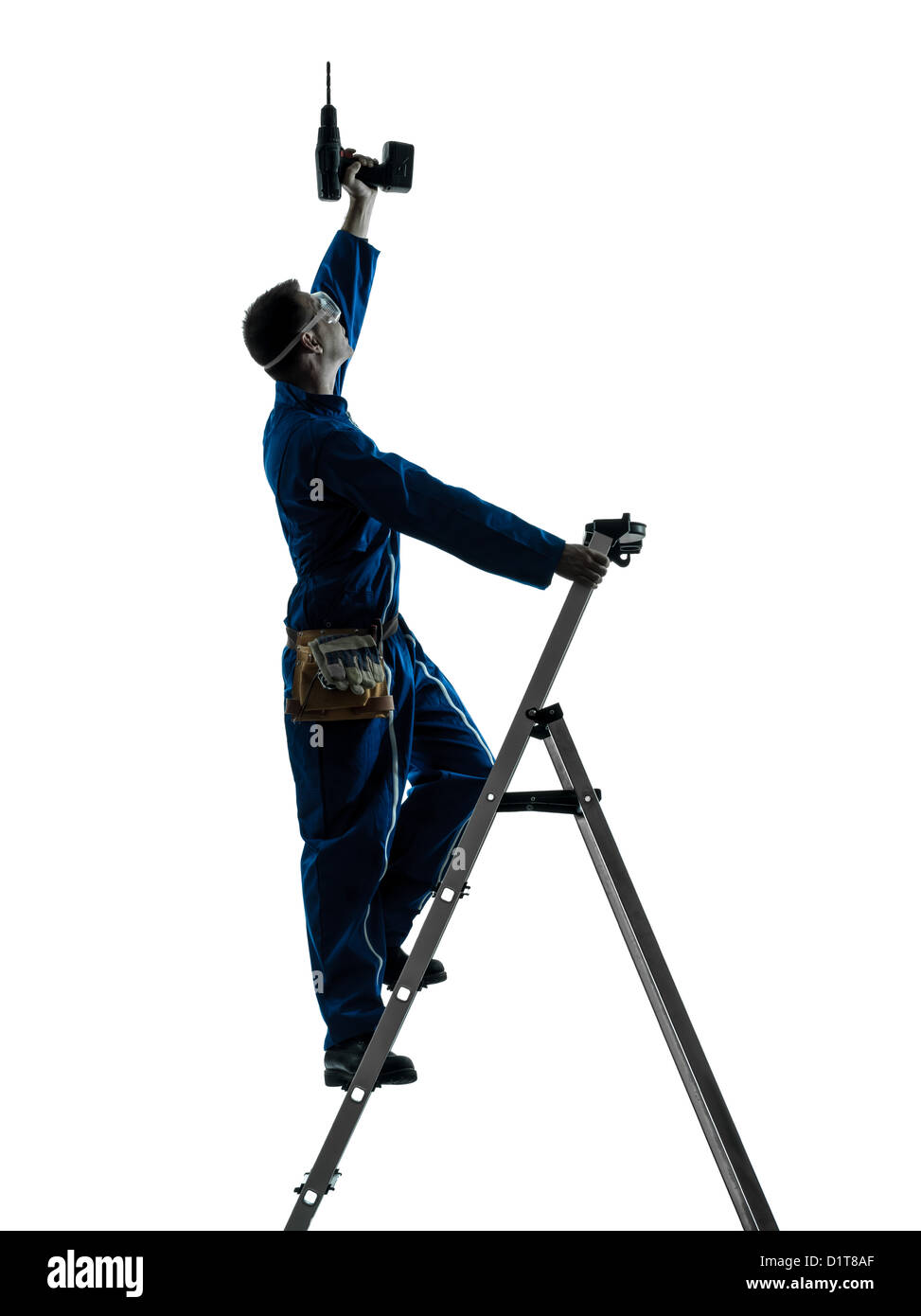 one  man construction worker holding drill silhouette in studio on white background - Stock Image