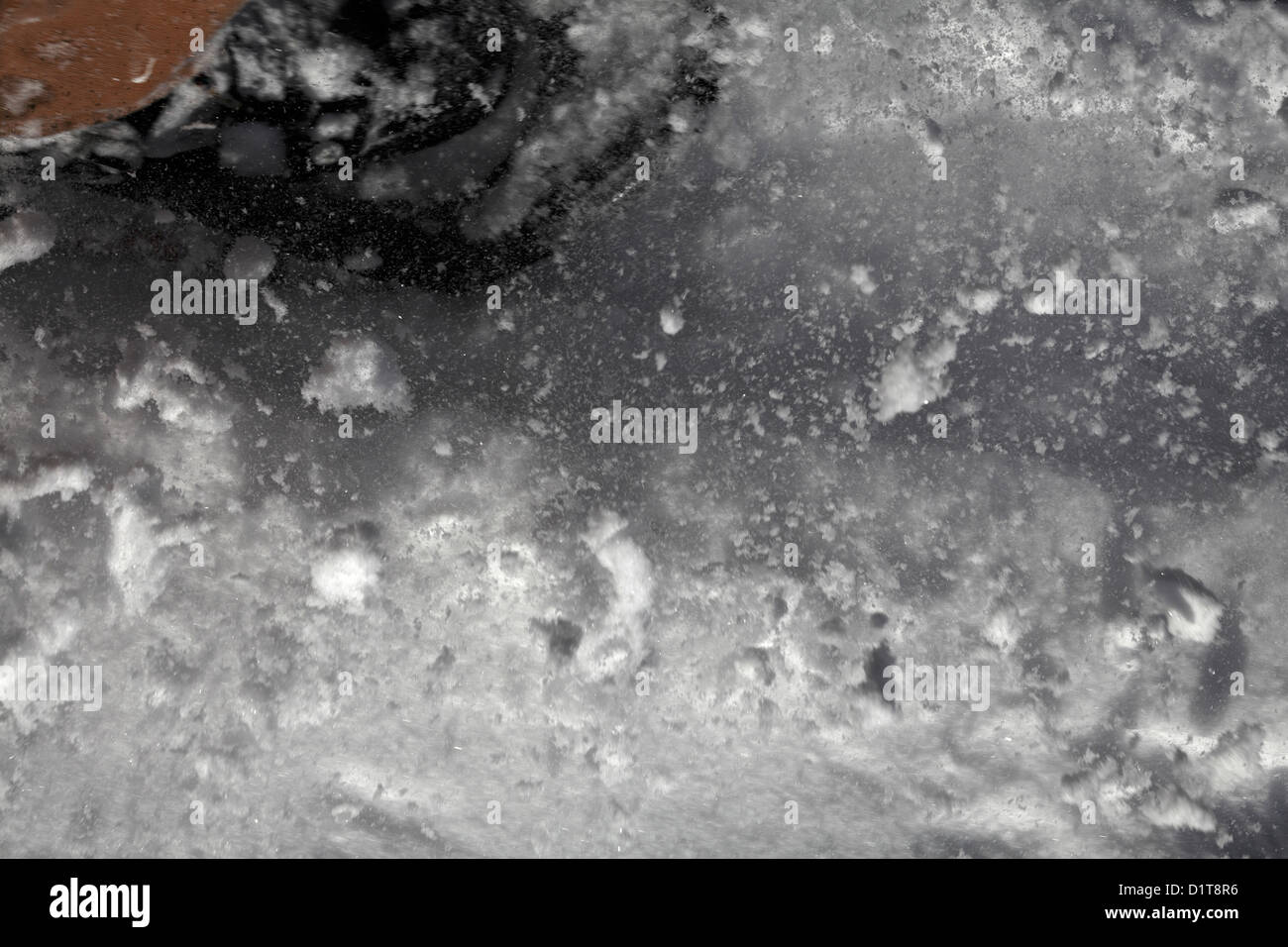 Snow particles in the air ahead of a snowshoe. Stock Photo