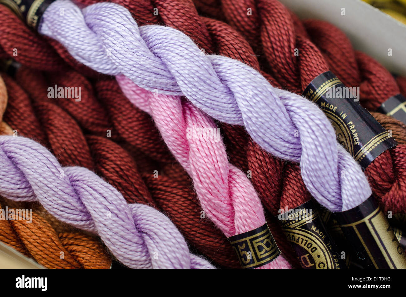 Skein of cotton thread jumbled together at a market stall - Stock Image