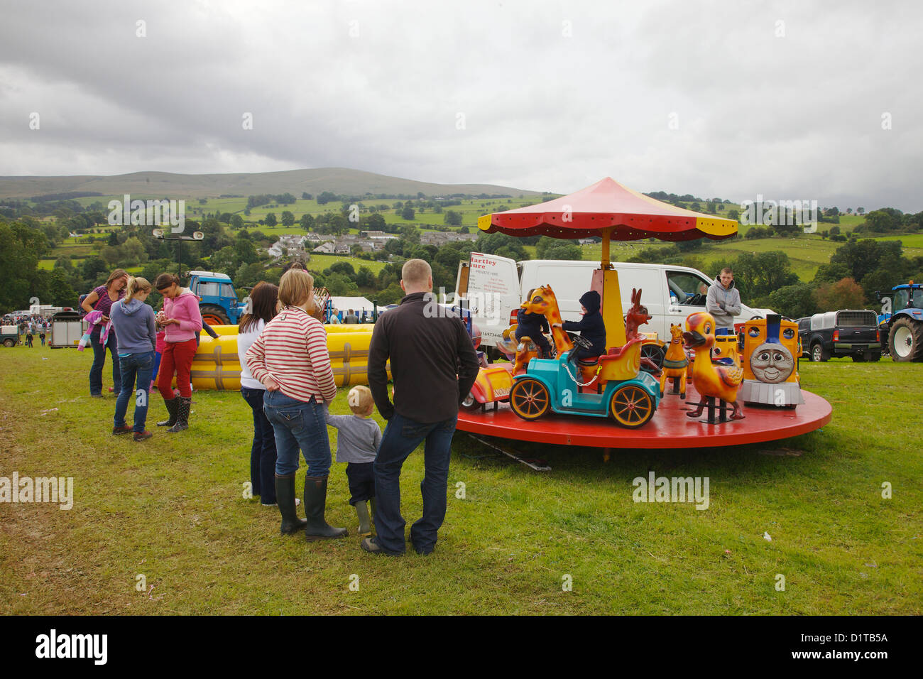 Families enjoyingt fun fair at Hesket Newmarket Agricultural Society Show Cumbria, England. United Kingdom,Great - Stock Image