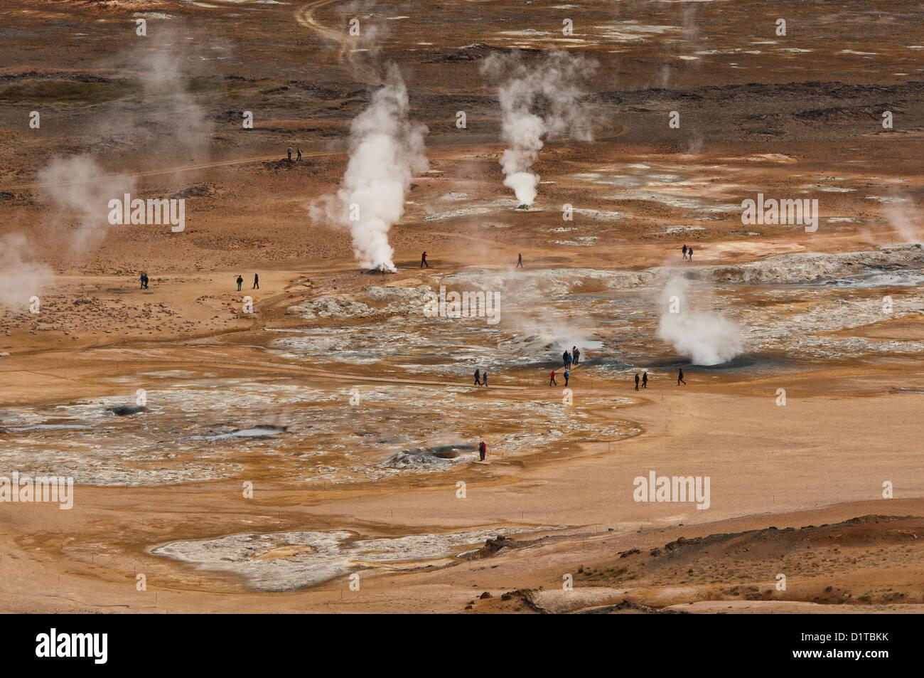 smoking fumaroles at the geothermal area of Hverir near Lake Myvatn, Iceland - Stock Image
