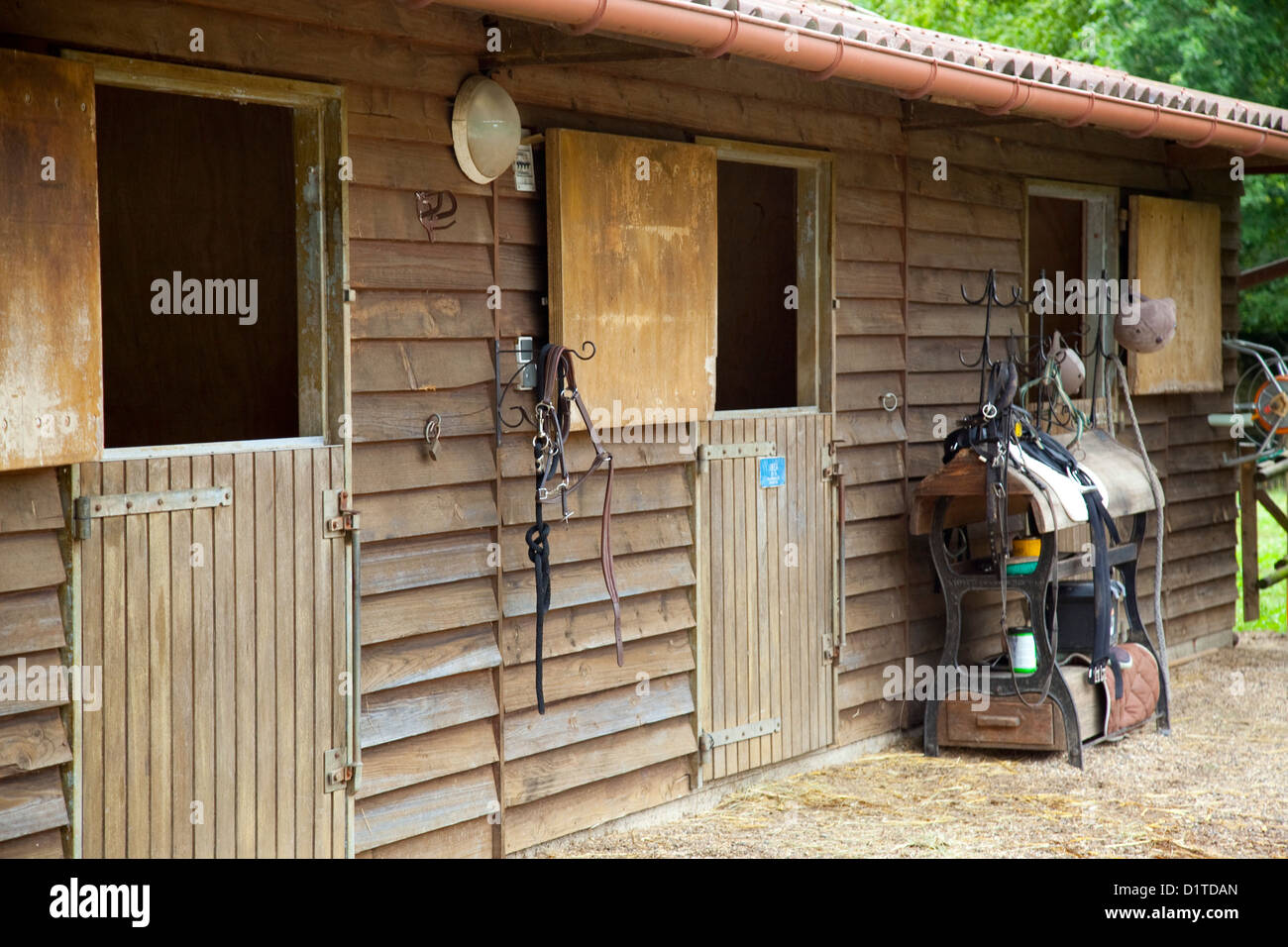 An outdoor view of a wooden horse stable with 3 doors in Chamont France. & Horse Stable Doors Stock Photos \u0026 Horse Stable Doors Stock Images ...