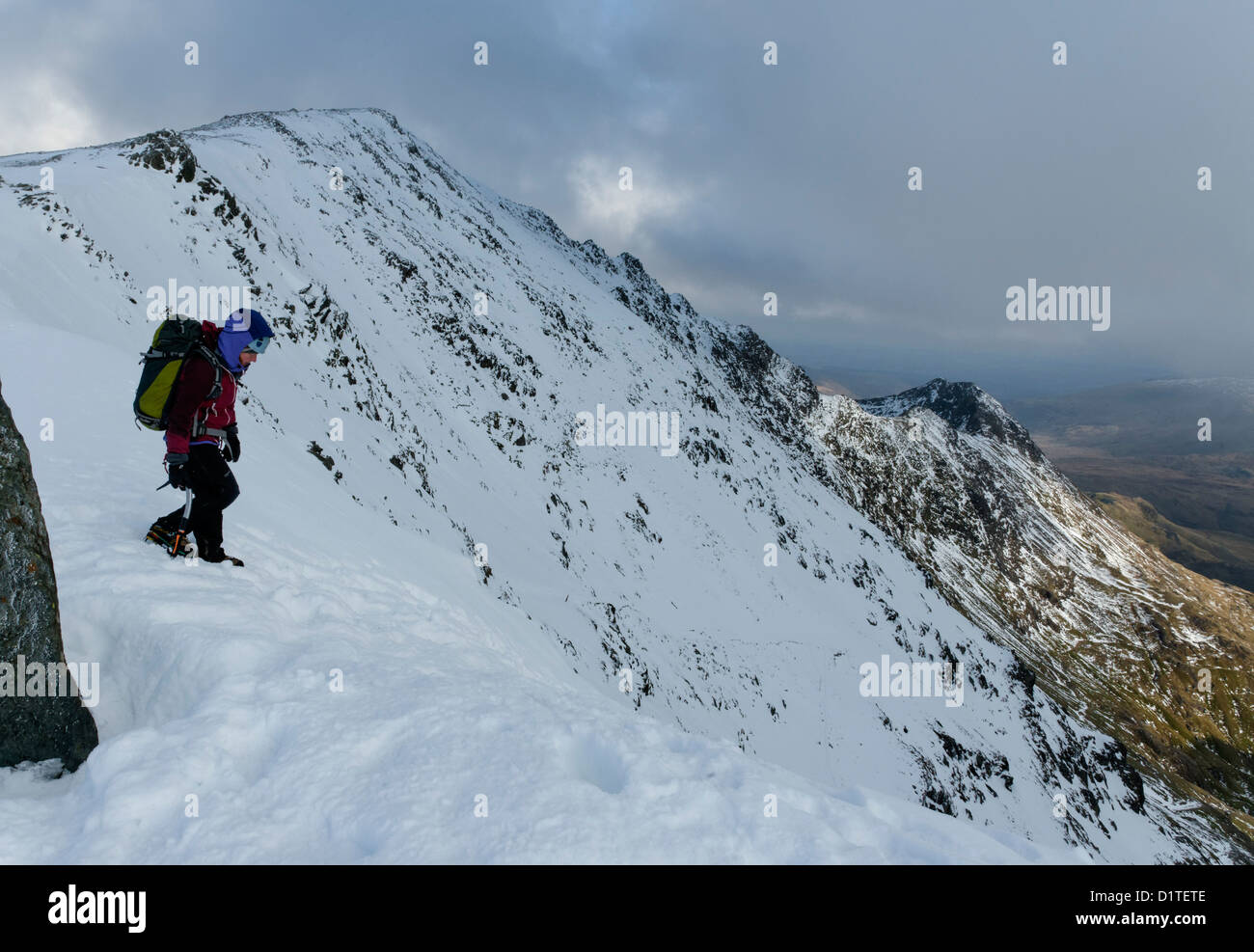 A hillwalker on Snowdon in winter conditions - Stock Image