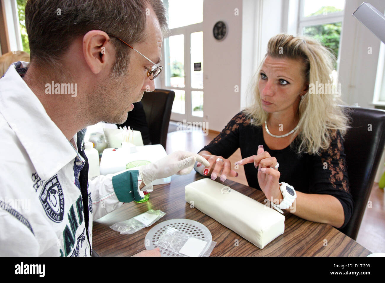 Berlin, Germany, a woman with a nail technician Stock Photo ...