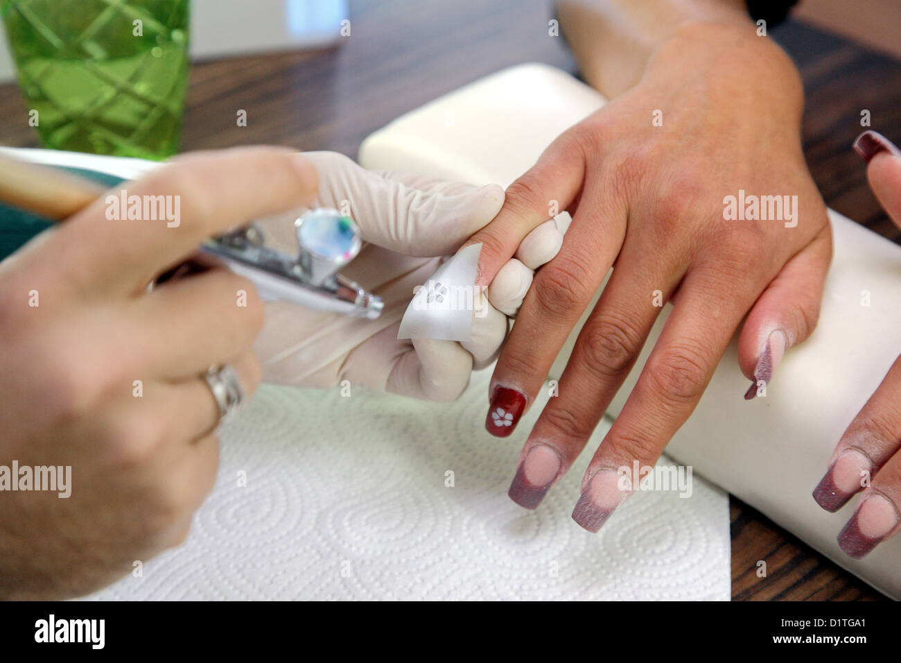 Berlin, Germany, a nail designer decorated nails with airbrush Stock ...